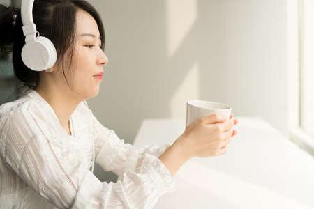 office lady holding a mug