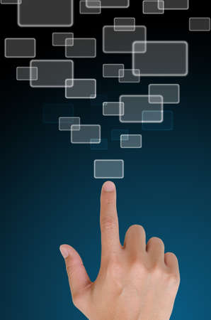 hand pushing a button on a touch screen interface in wide world.  Stock Photo