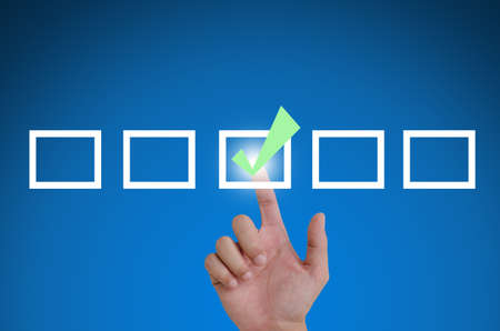 hand pointing a mark the check boxes. on a touch screen interface. Stock Photo - 10682037