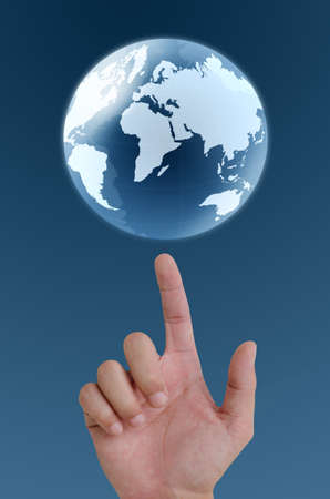 concept hand pointing earth globe. photo