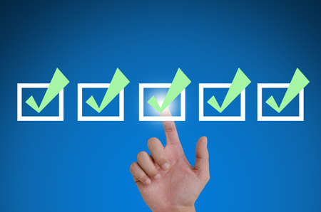 hand pointing a mark the check boxes. on a touch screen interface. Stock Photo - 10682039