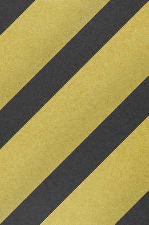 A hazard stripes background with grungy seamlessly  as  a pattern in any direction. Stock Photo