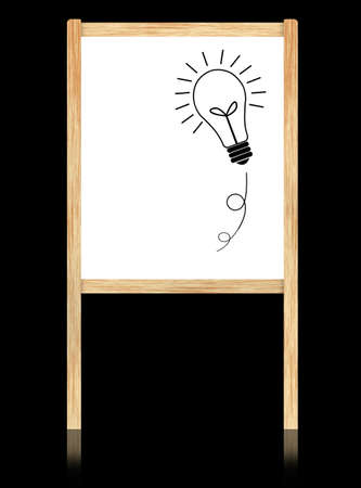 bulb idea on whiteboard with wooden frame  isolate on black background. photo