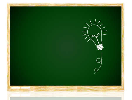 bulb idea on Green board with wooden frame isolate on white background. photo
