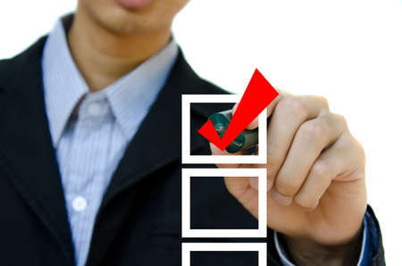 Business hand choosing mark the check boxes of many options.