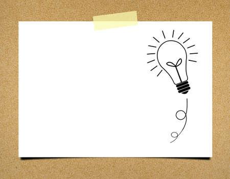 ฺBulb idea note paper on board background Archivio Fotografico