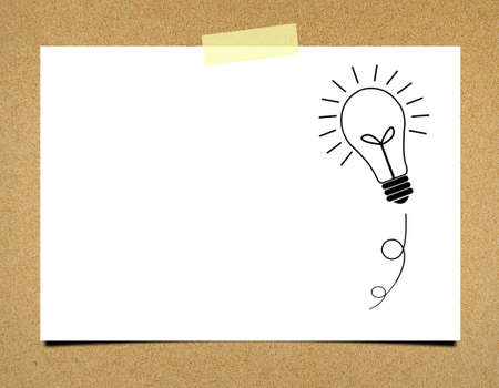 ฺBulb idea note paper on board background photo