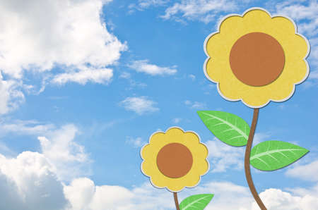 Sunflower recycled paper craft and blue sky. Stock Photo - 11269597