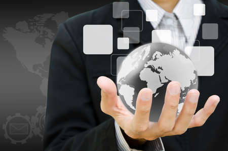 businessman hand holding the world and buttons Stock Photo - 12695893