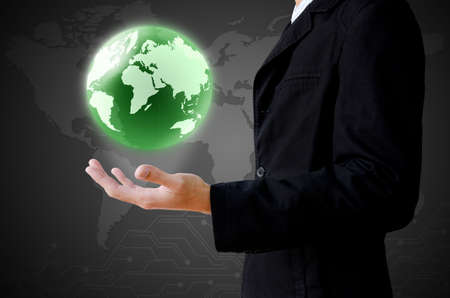 hand holding the earth globe photo