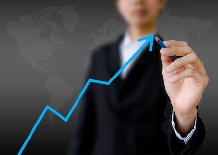 businessman hand drawing a graph Stock Photo - 12695703