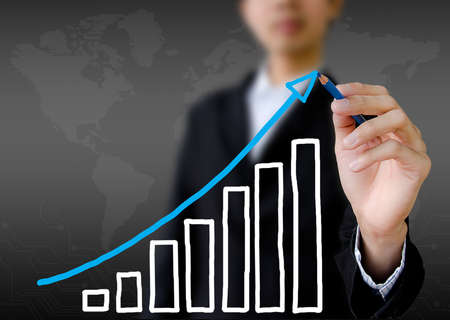 businessman hand drawing a graph  photo