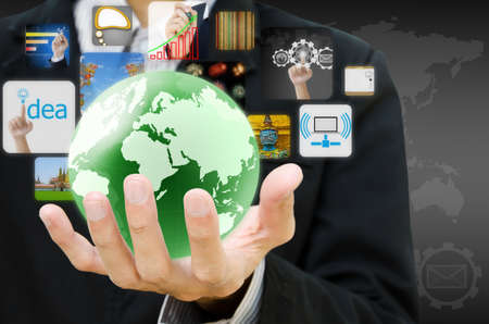 electronic devices: businessman hand holding world with image business collection Stock Photo