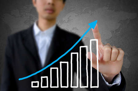 businessman hand pointing showing graph. Stock Photo - 12696118