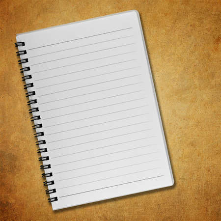 Blank notebook on old paper background photo