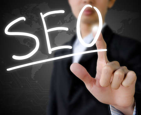 business hand touch virtual seo Stock Photo - 19329555