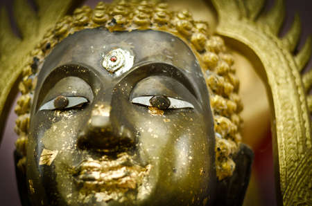Golden Buddha face photo