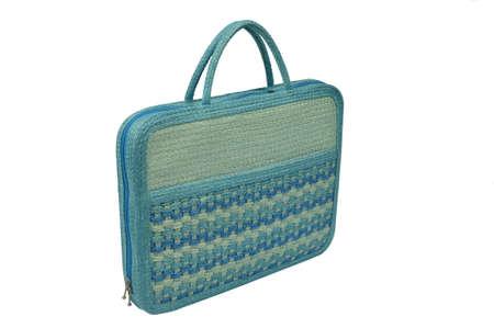 extravagance: wicker handbag on white