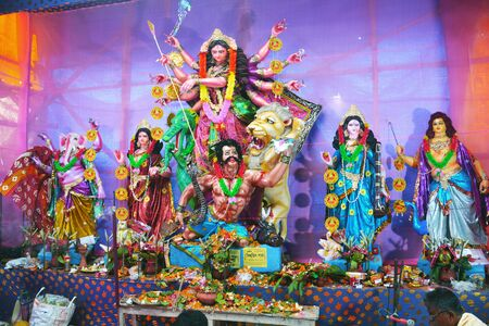 Goddess Durga Idol decorated at Durga Puja Pandal in village of rural West Bengal the biggest religious festival of people of west Bengal or Bengalis depicting victory of evil