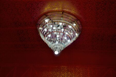 Close up of beautiful candelier, crystal chandelier, modern light  handing from pandal ceiling