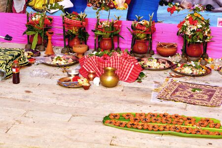 The Hindu Puja materials like earthen pots, mango leaves, flowers, earthen lamps, green coconuts, gamcha (Towel), brass and copper pots, dhunuchi (censer, incensory), etc.
