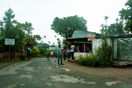 Mawlynnong, Shillong, Meghalaya, India, 16 June 2019 : The entrance to the cleanest village of Asia, Mawlynnong village, Shillong, with some small shops and people