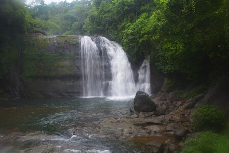 Waterfall of  the hills of Shillong in Meghalaya, silky blur water and natural surroundings with trees.