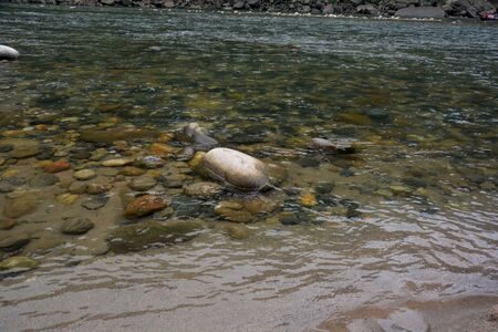 Some stones submersed in the clear water of river dawki, Shilong, Meghalaya in close up
