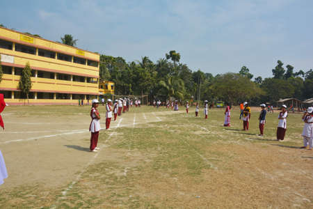 Chanda Bazar, Bongaon, West Bengal, India, 1 February, 2019: School girls lined up on both sides of track during school sports day of a village of India, selective focusing