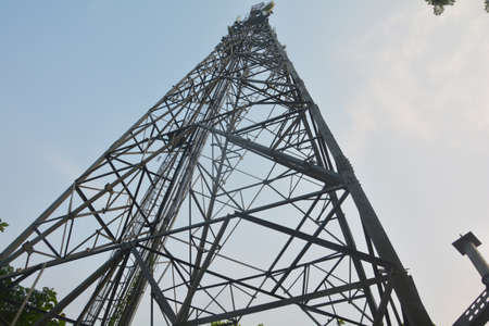 Long high angle shot of a mobile tower in India, selective focusing