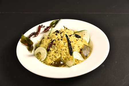 Chitranna is a rice-based dish widely prepared in South India. It is prepared by mixing cooked rice with a special seasoning called Oggarane or Gojju