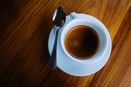 xwhite: Espresso coffee on wooden table Stock Photo