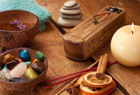Semi precious stones and aromatic sticks set up.