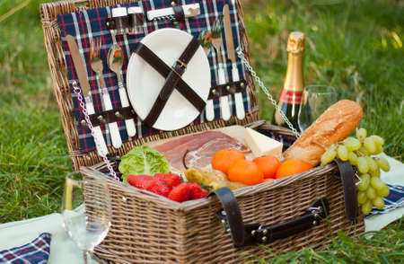 A picnic basket with food and champagne photo