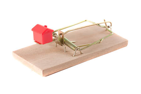 monopoly money: A monopoly house in a mouse trap. Symbolizing a bad motrgage contract. Stock Photo