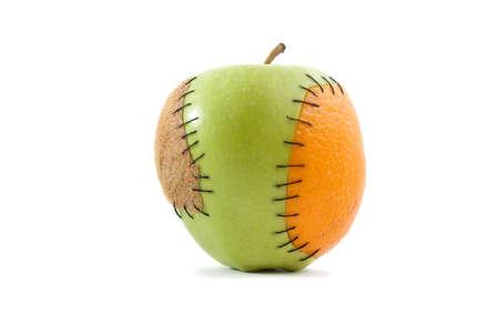 genetically engineered: An apple with orange and kiwi implants