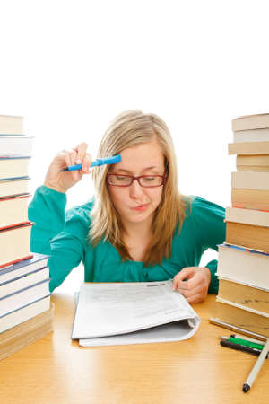 struggling: Young beautiful student concentrating hard on her studies