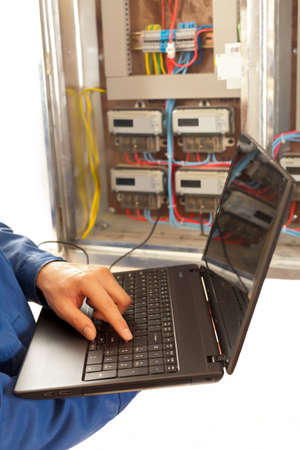 electronic survey: Using programs on laptop  for measuring at the distribution box  Stock Photo