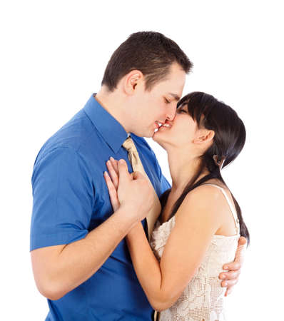 young lovers: Young couple having an intimate moment - kissing