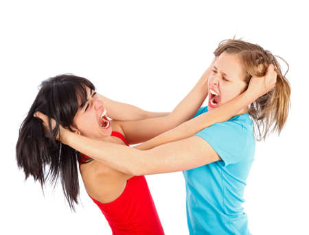 women fighting: Friends having a fight and tearing each others Stock Photo