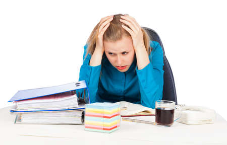 Young woman holding her head because of too much work  photo