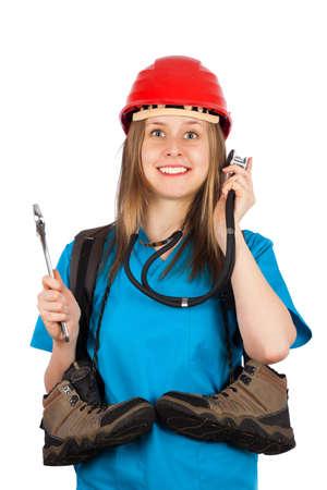 casco rojo: Feliz con la multitarea - mujer joven con varias profesiones Foto de archivo