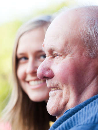 Beautiful granddaughter visiting her grandfather, being happy  Standard-Bild