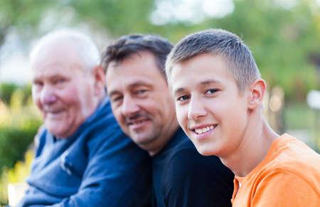 grandfather: Generaciones masculinas - abuelo, hijo y nieto. Foto de archivo