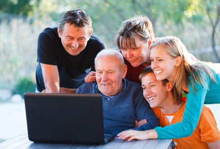 Family watching something interesting with grandfather.