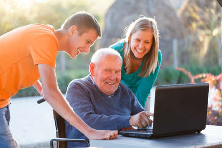 Grandfather successfully using the modern technology  Stock Photo