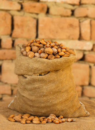 ground nuts: Sack full of seeds - almond, hazelnut and walnut  Stock Photo