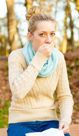 sensible: Young beautiful women suffering from influenza - coughing.