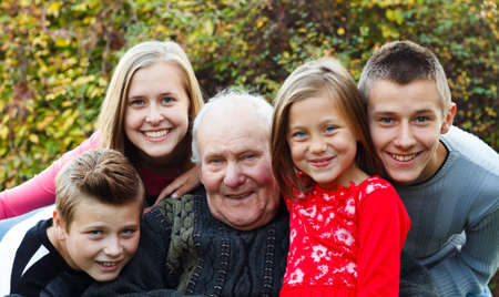 happy moment: Grandchildren visiting grandfather, giving him a happy moment. Stock Photo