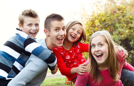 sister: Beautiful babysitter having fun with the children. Stock Photo